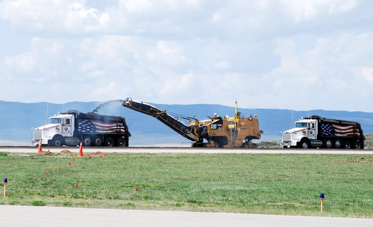 A diamond-toothed asphalt milling machine was close to completing removal of the old asphalt from the runway at Yampa Valley Regional Airport, Airport Manager Kevin Booth told county commissioners this week. The airport remains closed until June 15 during the construction.