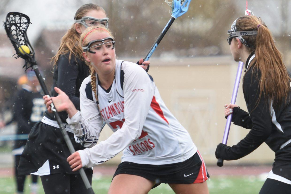Steamboat senior Becky Brown looks for a way to get a shot off Tuesday against Summit. Brown scored two goals in the game, but the Tigers mounted a second-half comeback to win, 9-7.