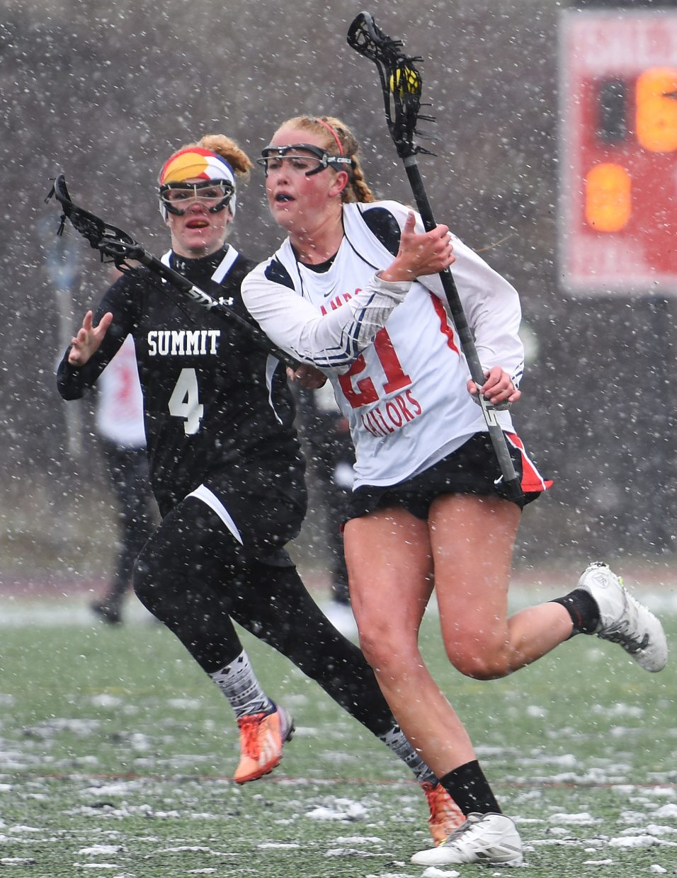 Steamboat's Becky Brown charges through the snow and up the field Tuesday against Summit.
