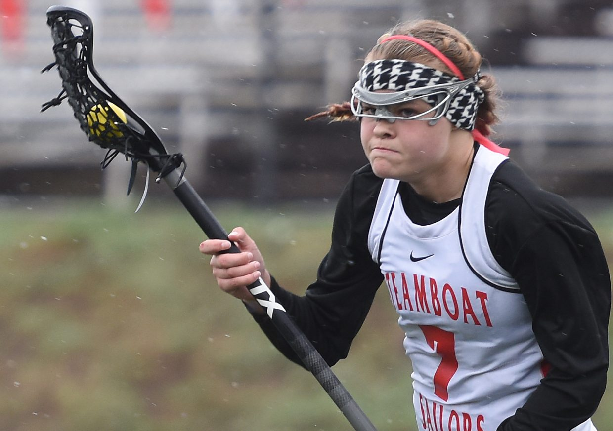 Lucy Shimek heads toward the goal Tuesday. She scored four times against Summit.