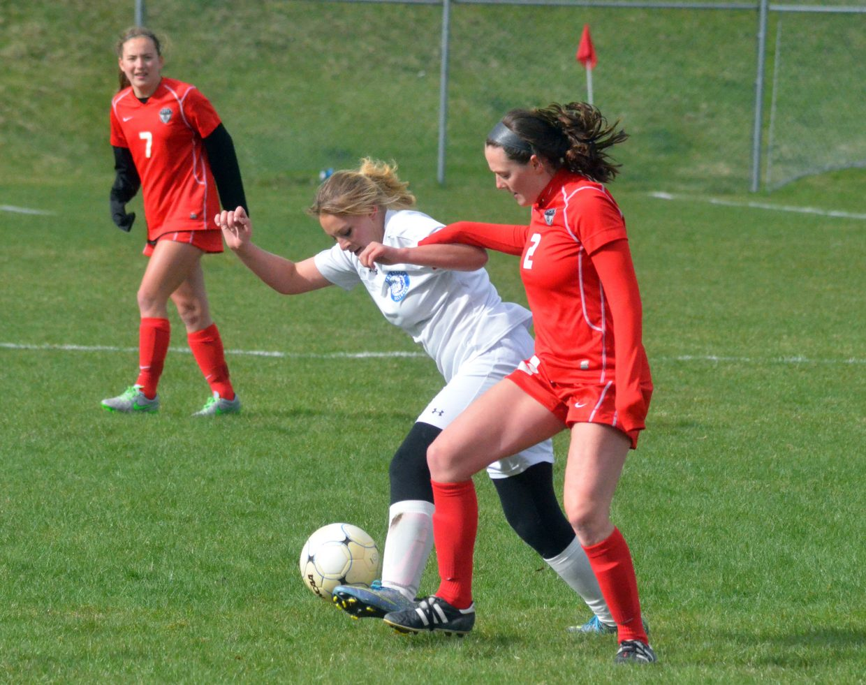 Moffat County High School's Sydni Tripp stays contentious against Steamboat Springs' Jordan Floyd (2) during the Bulldogs' Wednesday home game against the Sailors. Steamboat won, 10-0, improving to 10-1 overall, while MCHS is now 0-12 this season.