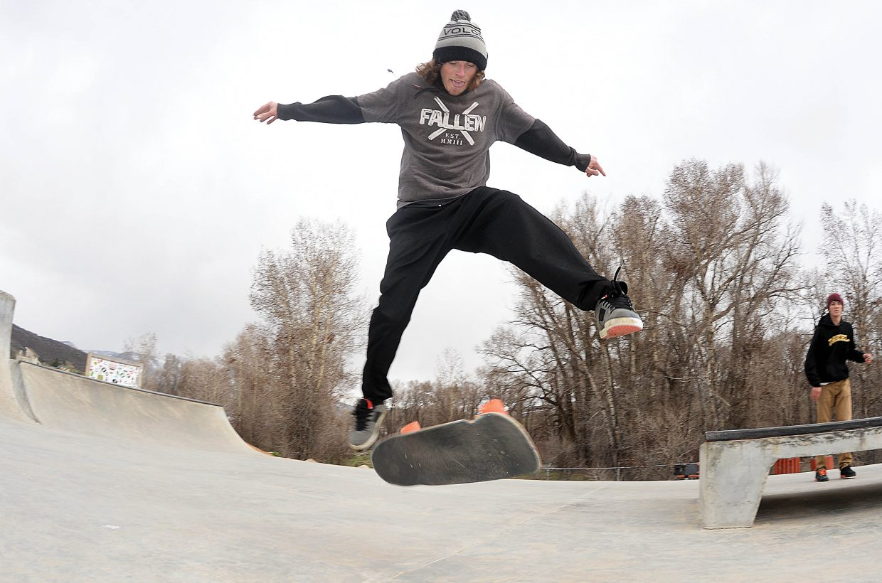 James Alvey works on his tricks at the Bear River Skate Park in Steamboat Springs on Monday afternoon.