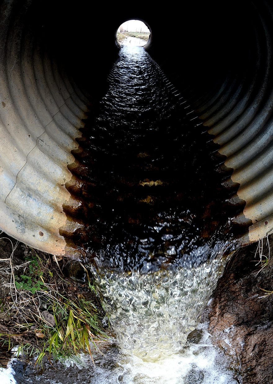 Water rolls through a drainage pipe near Steamboat Springs on Monday morning. Despite recent lower temperatures, snow in the Yampa Valley continues to melt.