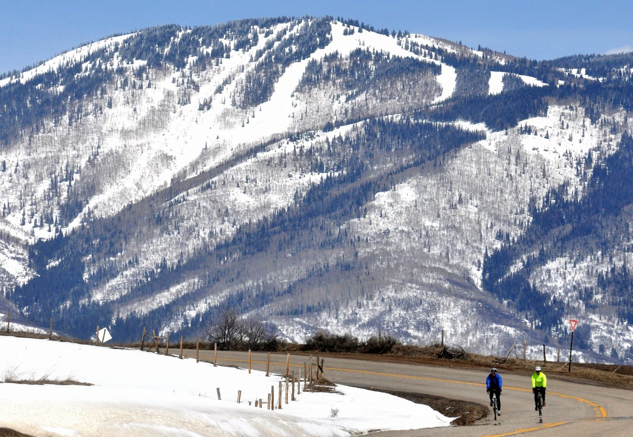 Steamboat Springs residents Laura Cusenbary and Jennifer Campbell go for a bike ride south of town as the ski slopes on Mount Werner loom behind them. The LiveWell Colorado Get Movin' challenge aims to get residents to do 30 minutes of physical activity each day next month.