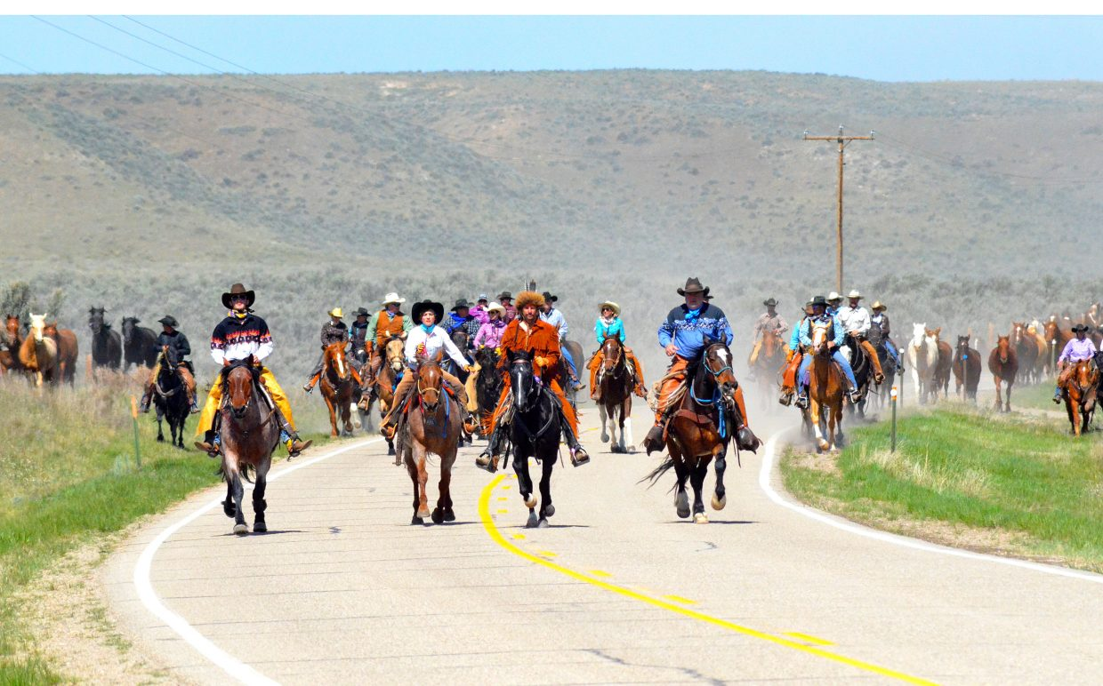 Riders in the 2015 Sombrero Horse Drive lead horses toward Maybell. Nearly 400 horses were taken from the Sombrero Ranch winter pasture in Browns Park to the spring pasture located 12 miles west of Craig.