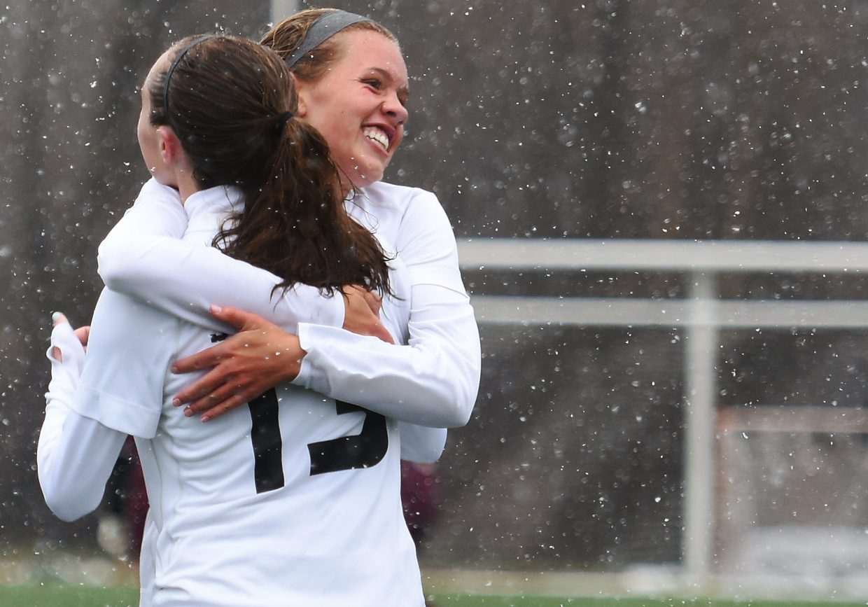 Steamboat seniors Natalie Bohlmann, right, and Mackenzie Gansmann celebrate after they combined for a second-half goal, Gansmann putting away a Bohlmann pass for a 2-0 lead against Palisade. The Sailors went on to win the game.