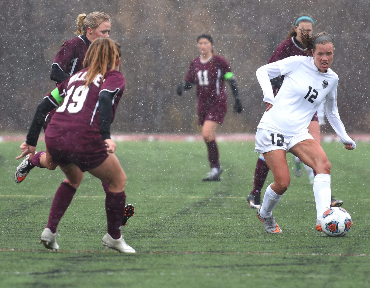 Steamboat senior Natalie Bohlmann pushes the ball up the field Friday against Palisade.
