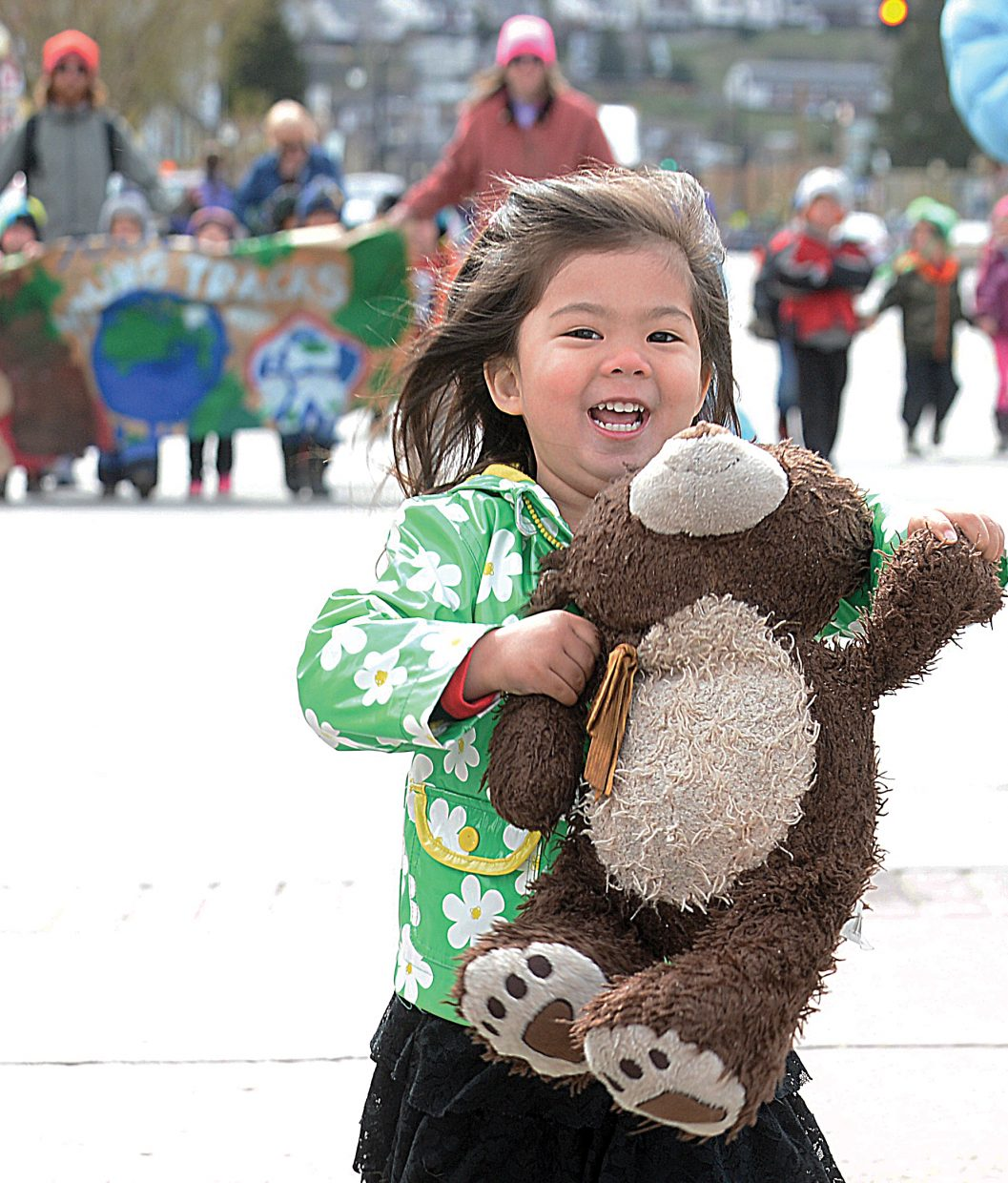 Kailyn Milne took her favorite teddy bear to the Children's Parade on Wednesday morning on Lincoln Avenue. The parade was part of the celebration of the Month of the Young Child.