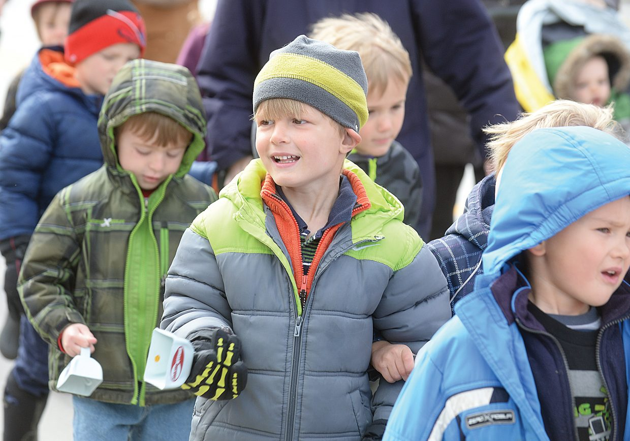 Peter Cooper makes his way down Lincoln Avenue with his classmates from the Discovery Learning Center on Wednesday as part of the Children's Parade. The parade was part of the Month of the Young child.