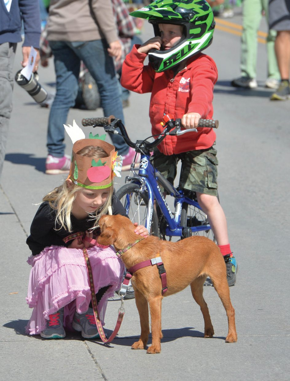 """Rockelle Worley take a few moments to visit with Kaida during the First Impressions Children's Parade in downtown Steamboat Springs Thursday morning. April was the """"Month of the Young Child"""" and the annual parade was part of the celebration in Steamboat Springs."""