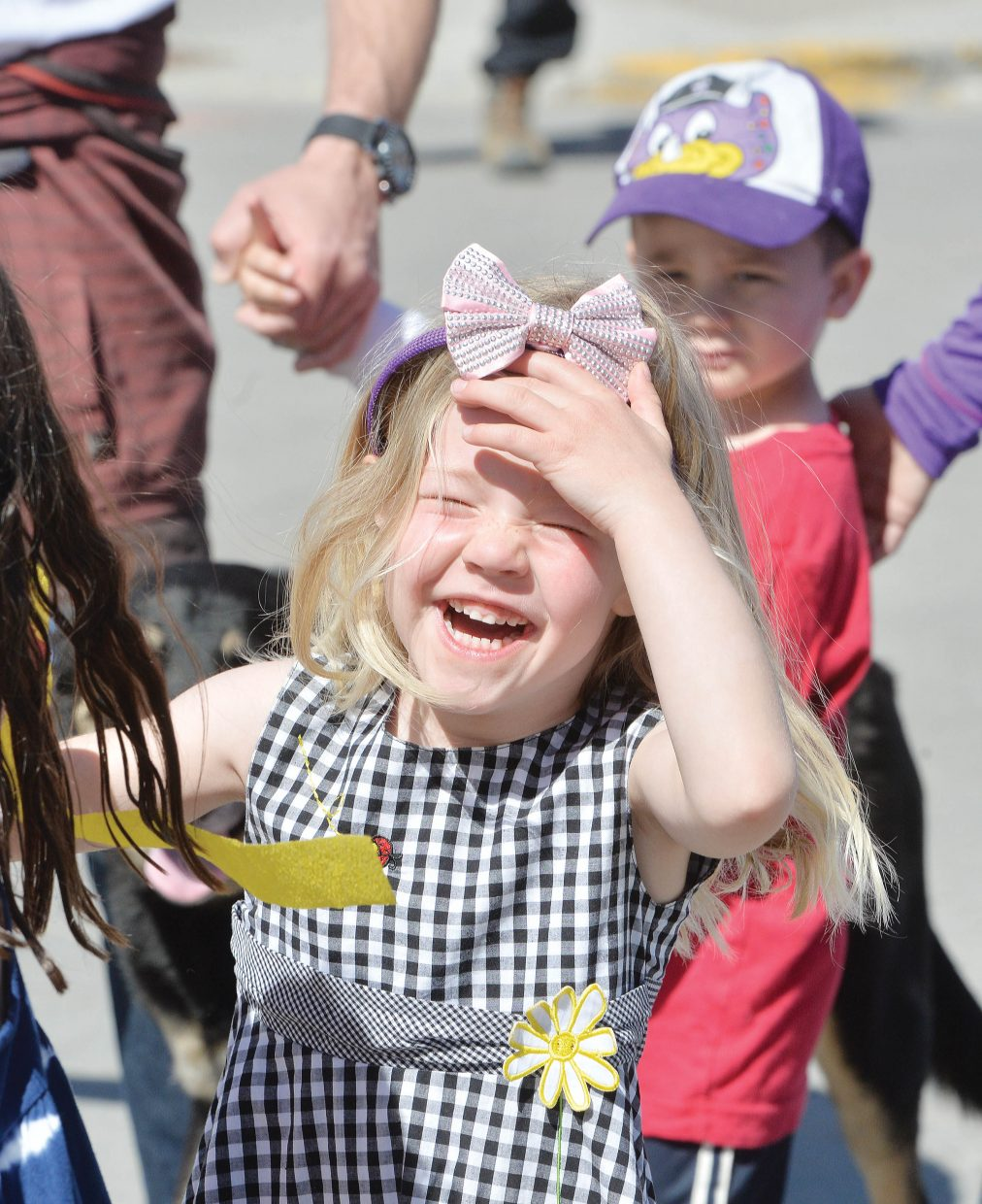 """The First Impressions Children's Parade was all fun, games and smiles for Discovery pre-kindergarten student Annabelle Metcalf. April was the """"Month of the Young Child,"""" and the annual parade was part of the celebration in Steamboat Springs."""