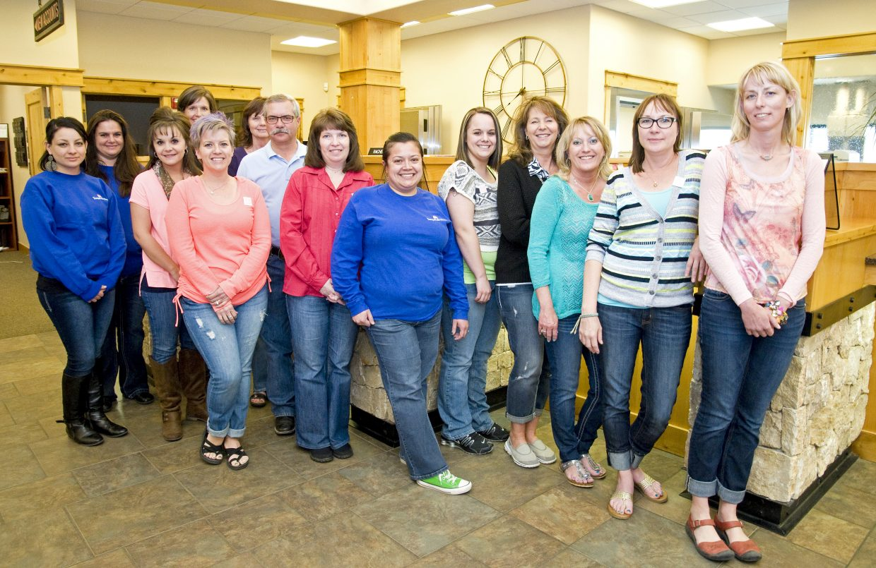 """Employees at Yampa Valley Bank sport denim jeans on Wednesday and buttons that read, """"There is no excuse and never an invitation to rape,"""" in support of Denim Day. Fifteen Moffat County businesses and organizations, including Mayor Ray Beck and Craig City Council, participated in the international event. Organized locally by Advocates Crisis Support Services, the event seeks to raise awareness about sexual violence and sexual assault."""