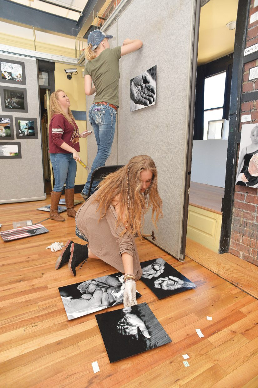 Steamboat Springs High School student Madi King hangs her photograph for the Steamboat Springs AP art class exhibit.