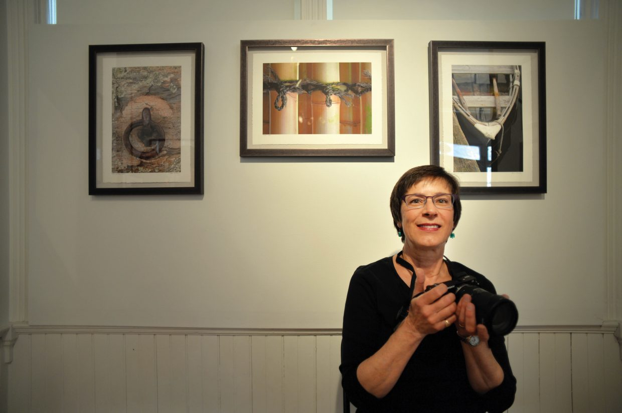 Photographer Lana Turner poses in front of her work at the Wabi-Sabi art show, which opens Friday evening at the Depot Art Center. Wabi-Sabi is a the idea that nothing lasts, nothing is finished and nothing is perfect.