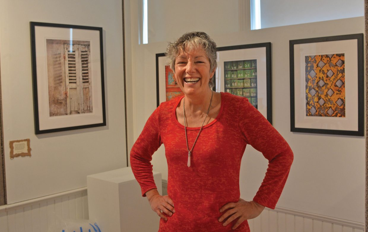 Photograper Lynne Garell poses in front of her work at the Wabi-Sabi art show, which opens Friday evening at the Depot Art Center. Wabi-Sabi is a the idea that nothing lasts, nothing is finished and nothing is perfect.