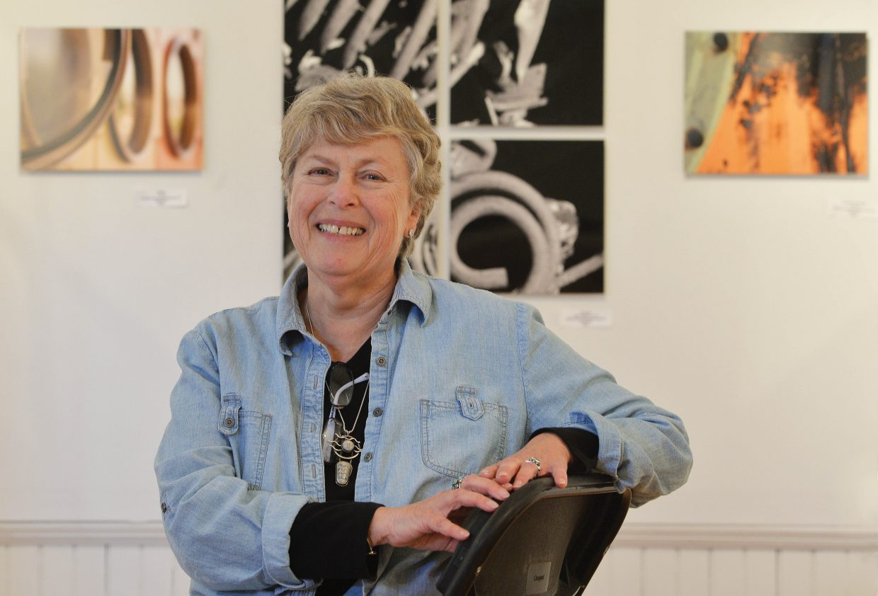 Photograper Barbara Carpenter poses in front of her work at the Wabi-Sabi art show, which opens Friday evening at the Depot Art Center. Wabi-Sabi is a the idea that nothing lasts, nothing is finished and nothing is perfect.