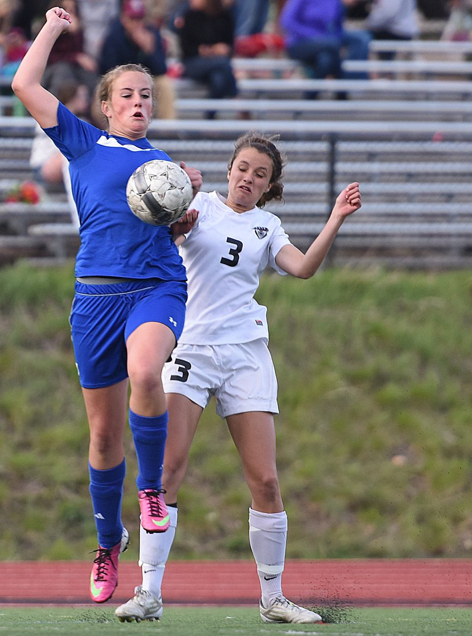 Steamboat's Eliza Leeson tries to fight for a ball Thursday against Moffat County.