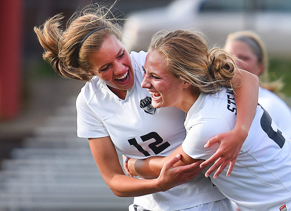 Steamboat's Lauren Anderson, right, and Natalie Bohlmann celebrate after Anderson's first-half goal in Thursday's 4-0 win against Moffat County. It was the first goal of Anderson's career and the first of the night for the Sailors.