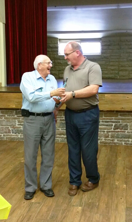 Al Shepherd accepts the Moffat County United Way Volunteer of the Year award from board member and City Councilor Joe Bird Wednesday at the Moffat County Fairgrounds Pavilion. Shepherd has been a part of community service for decades, involved with Craig Lions Club, Elks, Kiwanis Club and more service organizations throughout his life.