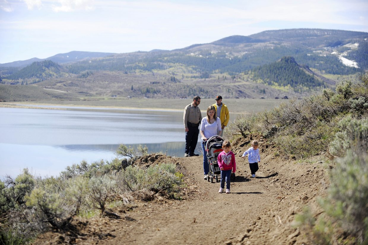 """The Lehman family walks with David """"DJ"""" Winter on a new trail Winter built at Stagecoach State Park."""