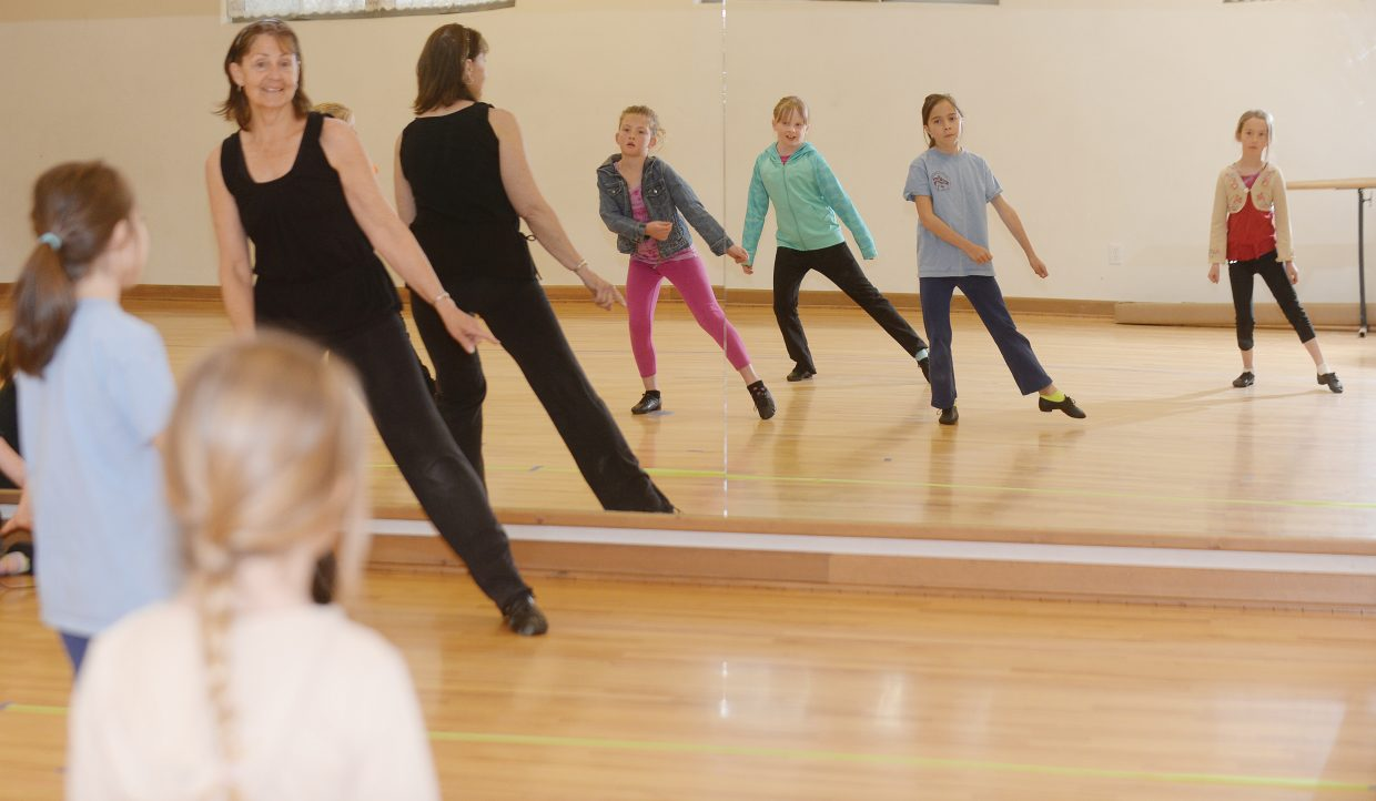 Dance instructor Tamara Bereznak rehearses with the youth group for this Saturday's Let's Dance Spring Dance Program. The show will take place at 7 p.m. at Soroco High School.