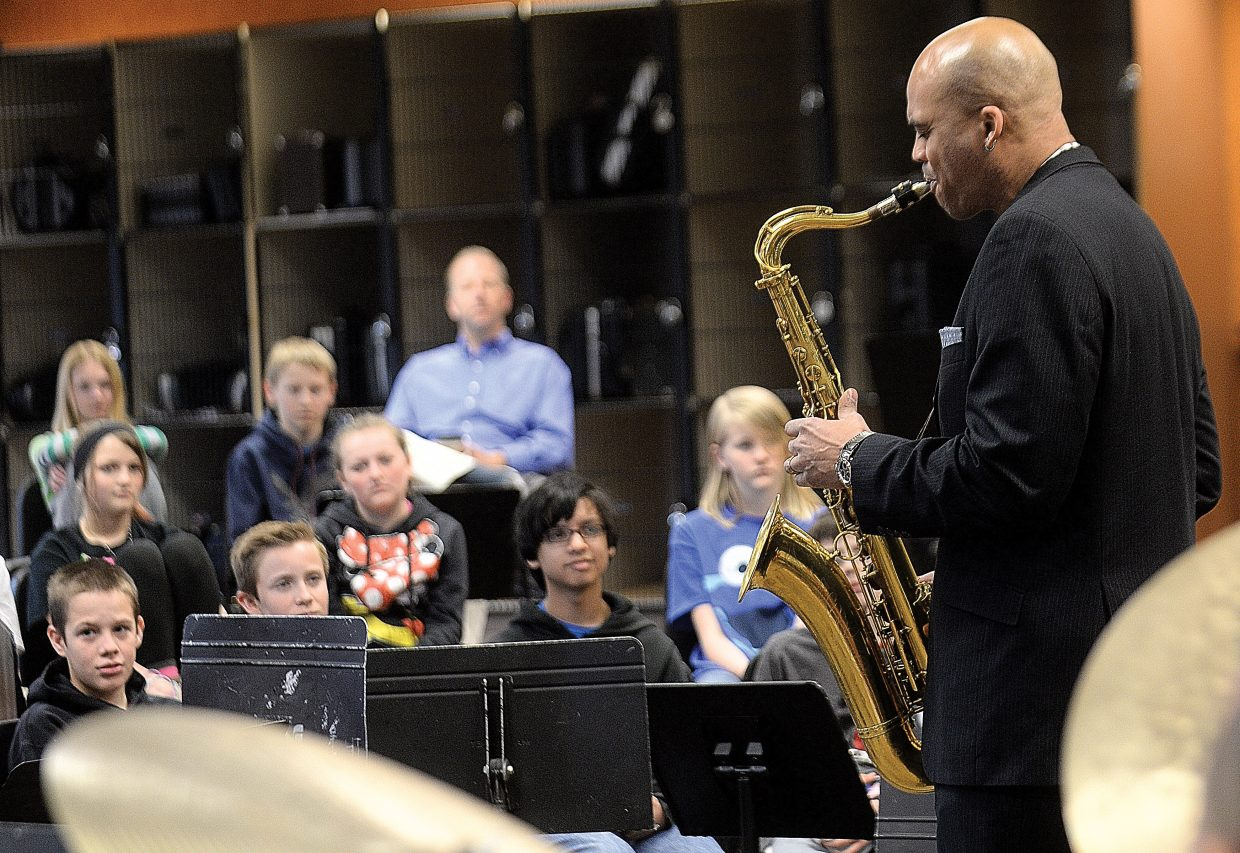 Wayne Escoffery, who plays the tenor saxophone with JazzReach, performs for the Steamboat Springs Middle School band Wednesday morning. JazzReach has been selected for the Strings School Days program and will spend the next two years working with local students as part of a residency program.