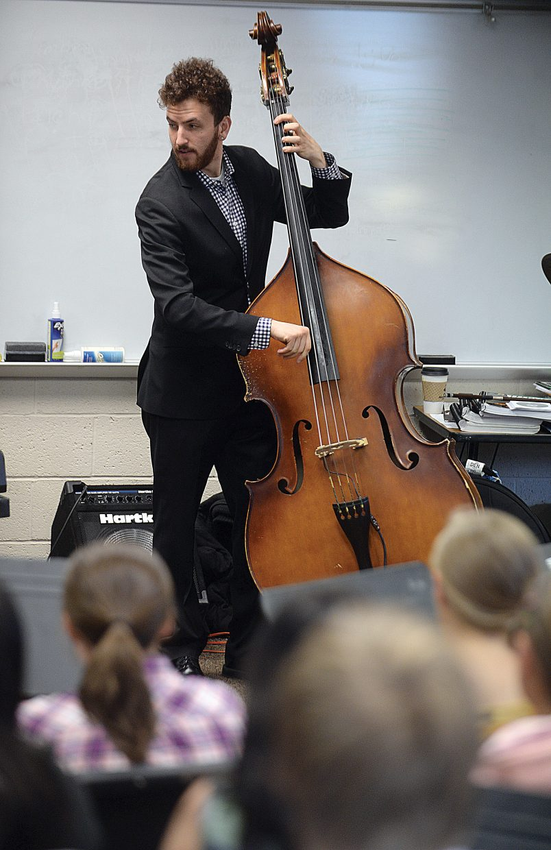 Zach Brown, who plays bass with JazzReach, performed for the middle school band Wednesday morning.