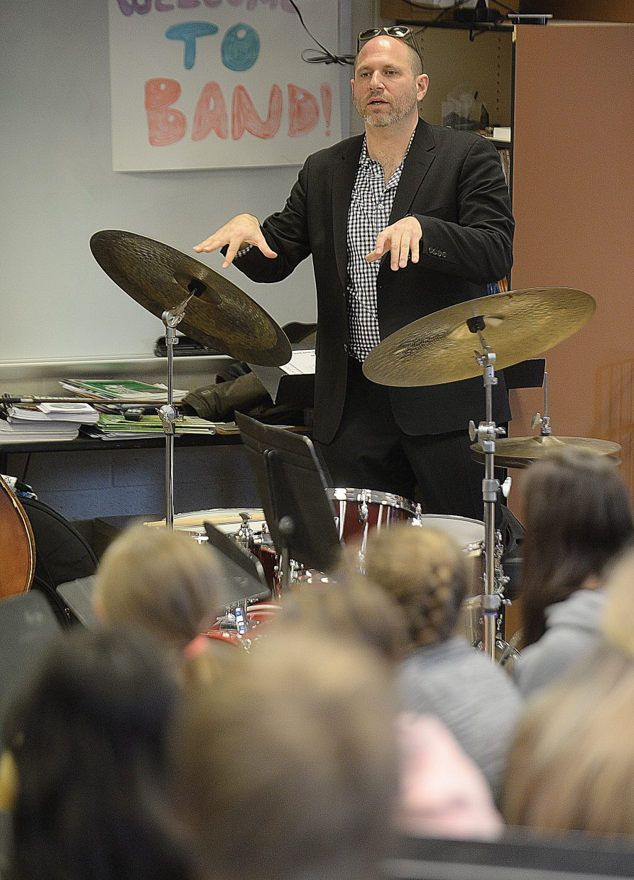 Hans Schuman, founder of JazzReach, talks with students during a visit to Steamboat Springs Middle School on Wednesday. JazzReach has been selected for the Strings School Days program and will spend the next two years working with local students as part of a residency program.