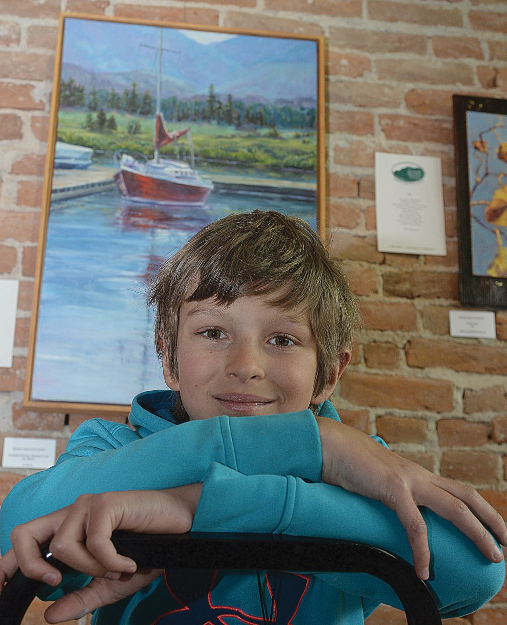 Emerald Mountain School student Thomas Faunce found inspiration in this art work by Dancy St. John on display at the Circle & Gallery in Steamboat Springs.