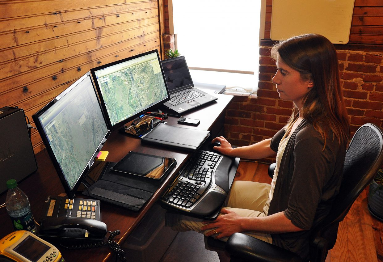 Mary Schuette puts the finishing touches on a new interactive trails map for the city of Steamboat Springs. As the city's geographic information systems administrator, Schuette provides both the public and city departments with useful maps.