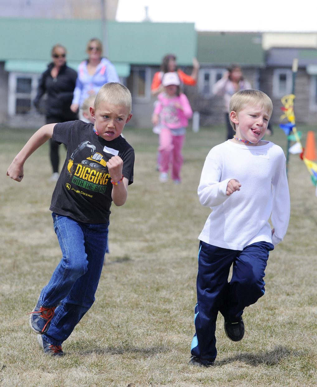 South Routt Elementary School second graders Trey Louthan and Garren LaCroix race to the finish line Thursday during the school's annual mile-long fun run. Fifth grader Liam Yaconiello was the first boy to finish and third grader Shelby Geiger was the first girl.