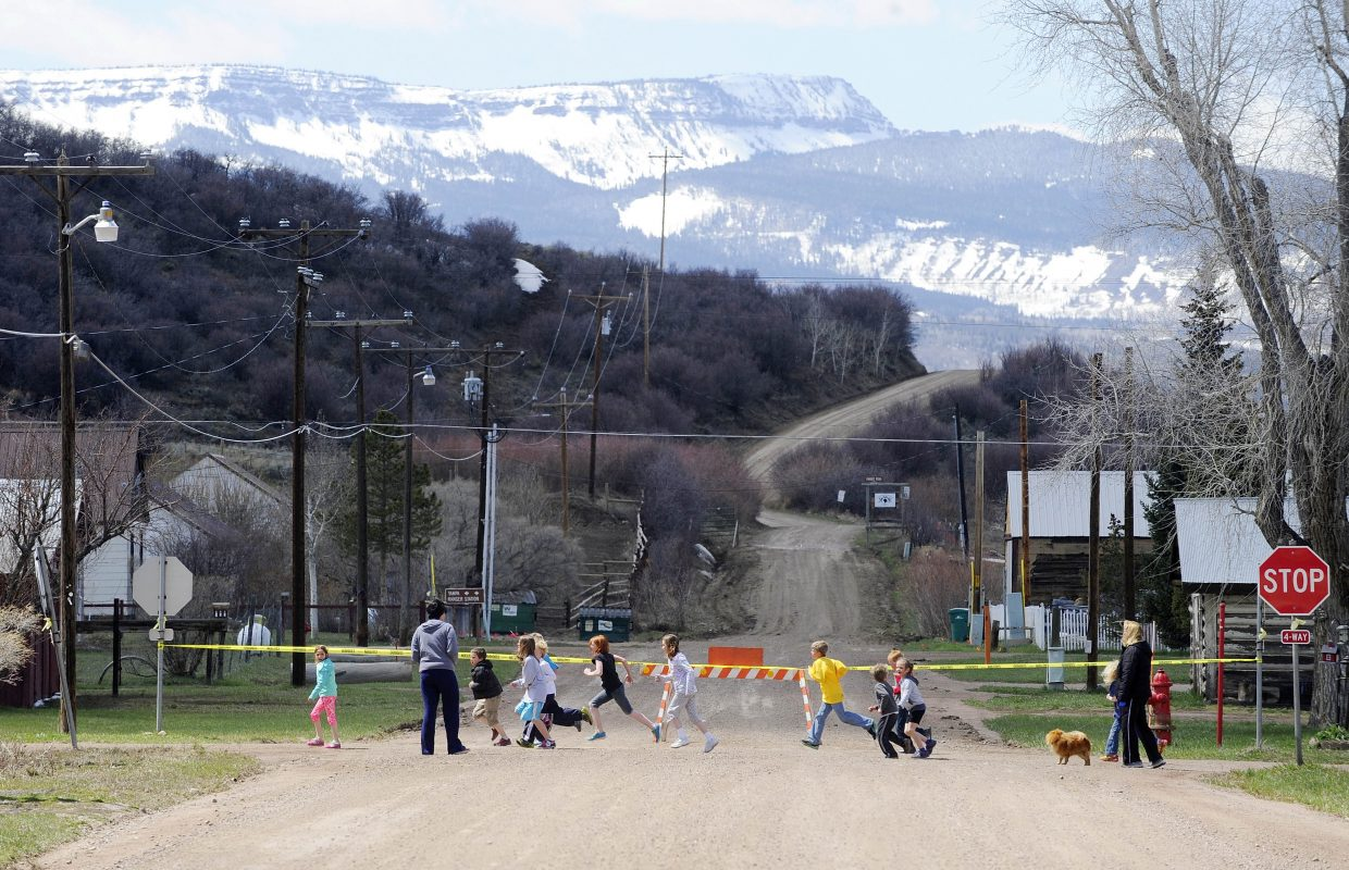 South Routt Elementary School students run Thursday with the Flat Tops Wilderness Area in the background.