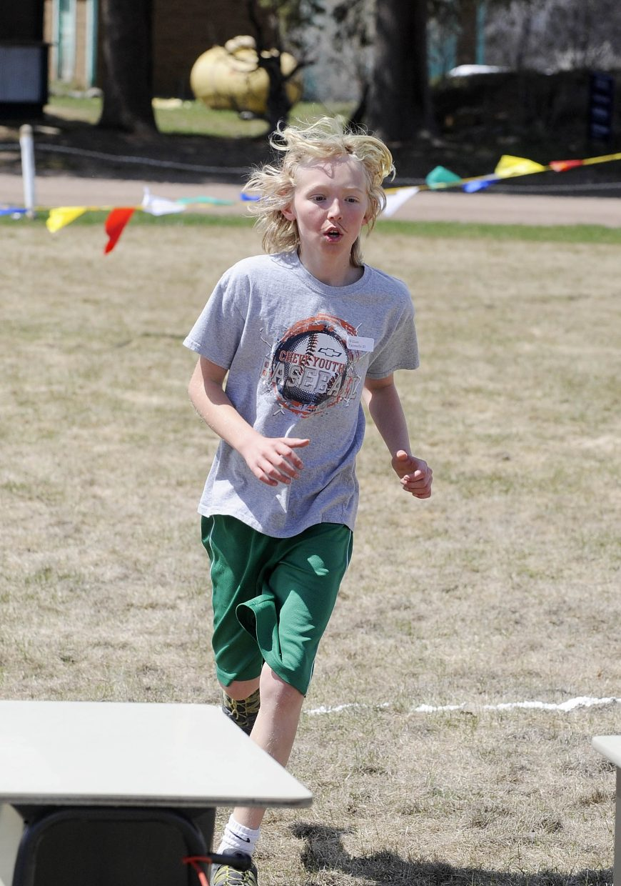 The first boy to finish, fifth grader Liam Yaconiello, crosses the finish line.