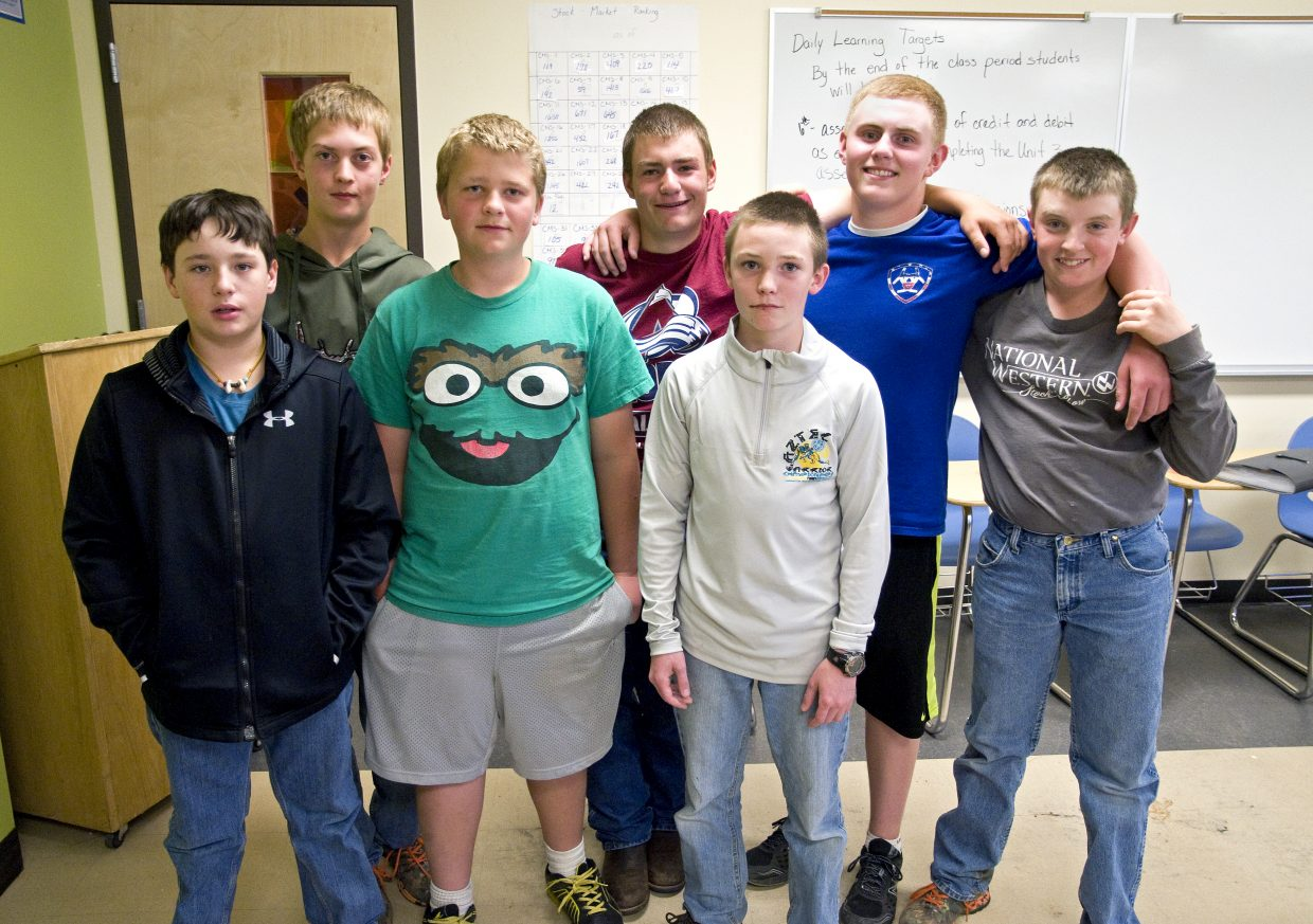 Seventh graders Jace Booco, Beau Hollander and Grayden Spears, left, comprised one of three teams that swept the regional competition for the Stock Market Experience this year. In front, seventh-grader Daniel Caddy worked as a team of one, and back center and right, eighth-graders Logan Knez, Jared Baker and Grady Anson placed first at regionals and took second statewide. The teams celebrated their successes at an awards presentation in Denver on Friday.