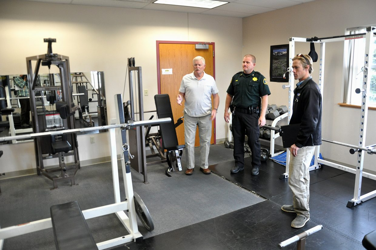 Craig Police Chief Walt Vanatta, left, and Moffat County Sheriff KC Hume show Steamboat Springs police station committee member Charlie MacArthur the shared workout facility in the Moffat County Public Safety Center.
