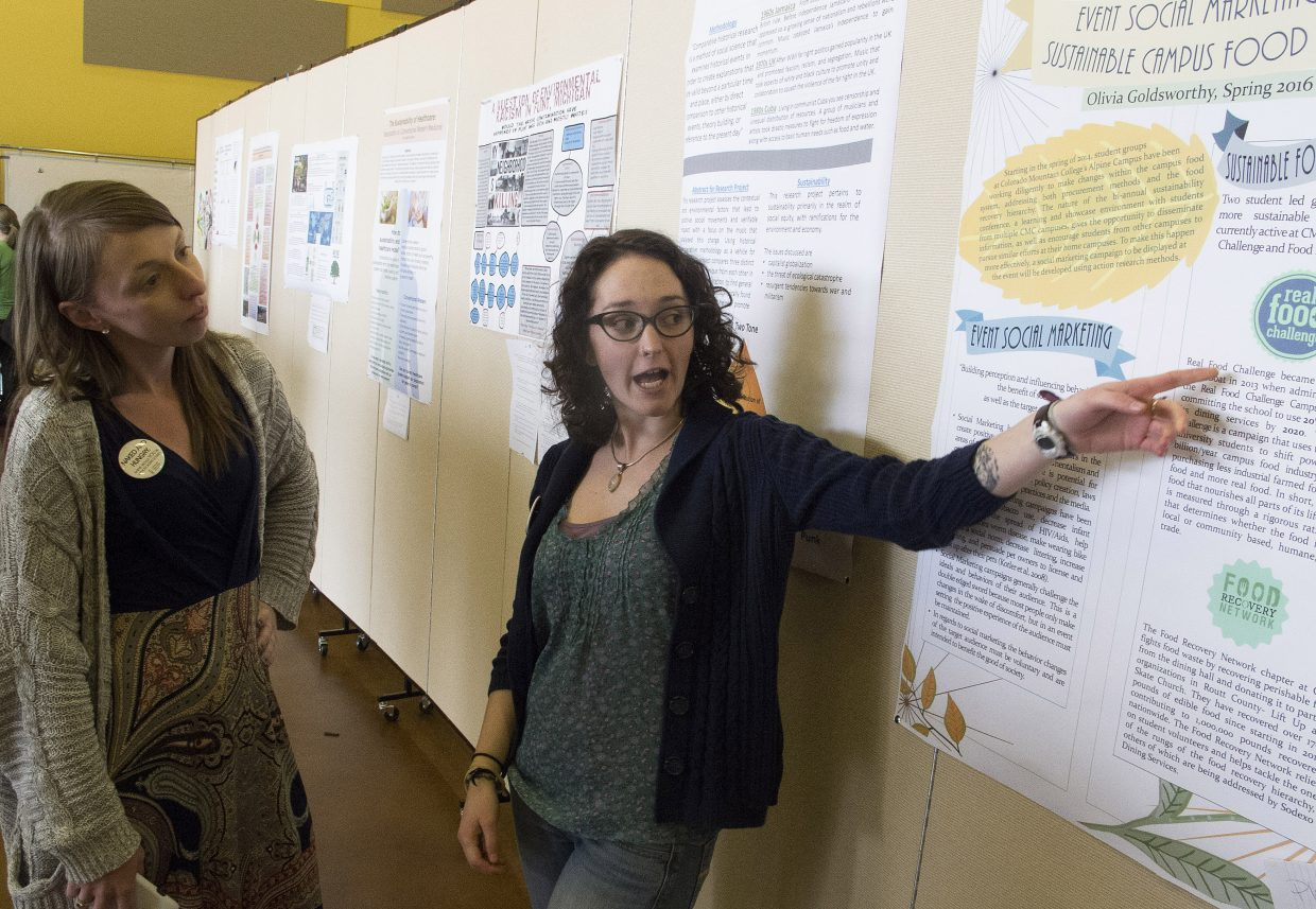 Sustainability studies student Olivia Goldsworthy, right, explains her poster to fellow student Molly Goldberg at Colorado Mountain College's Sustainability Conference in Steamboat Springs in April. Goldsworthy's poster explains her recent internship, which involved researching sustainable food sourcing and preparation, as well as waste minimization.