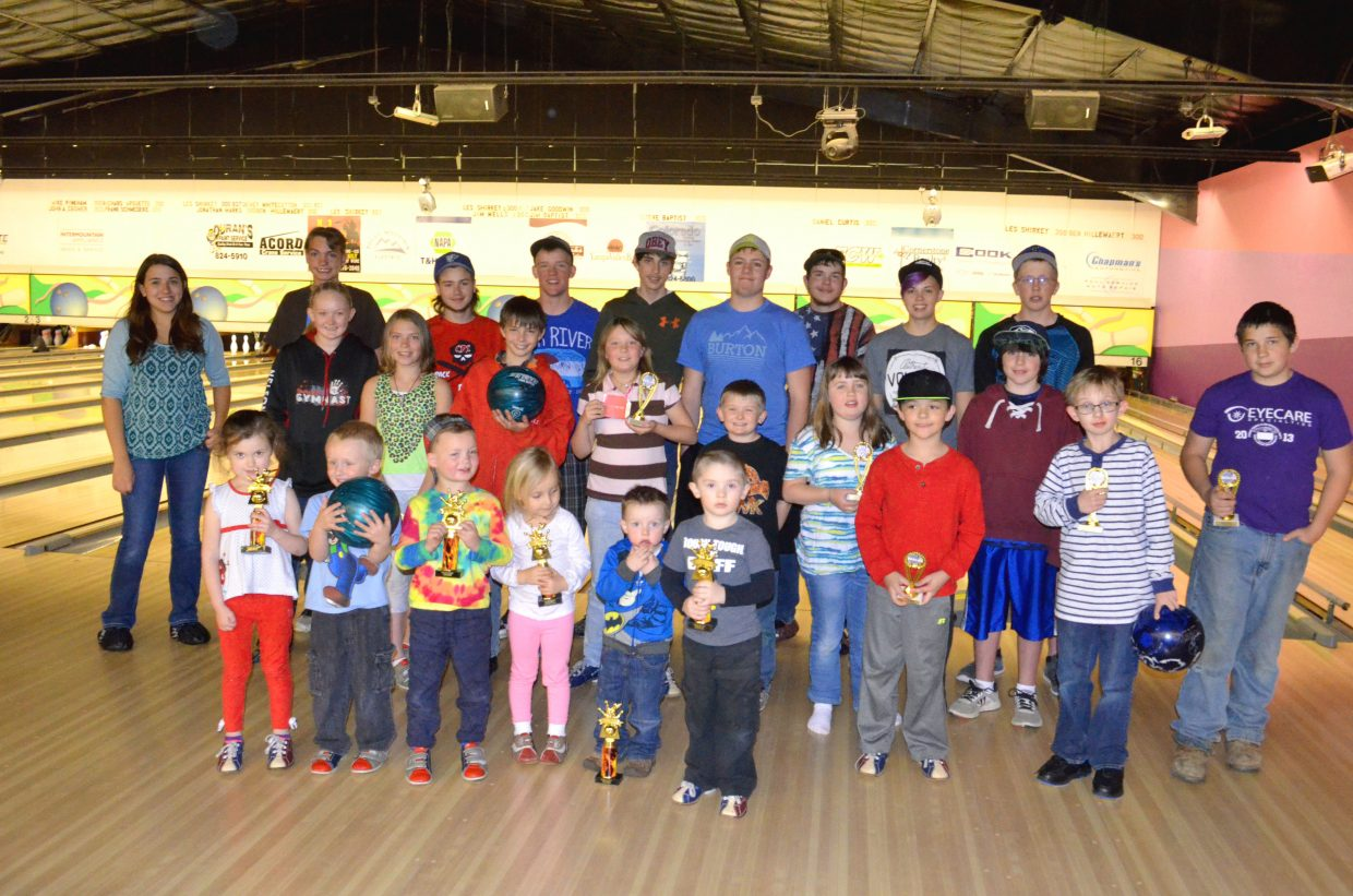 The members of Thunder Rolls Bowling Center's youth bowling series gather on the lanes with their collection of trophies. The age levels including the Peewees, front row, Bantams, middle row, and High Rollers, bak row, were honored Sunday with a banquet for months of progress in the sport.