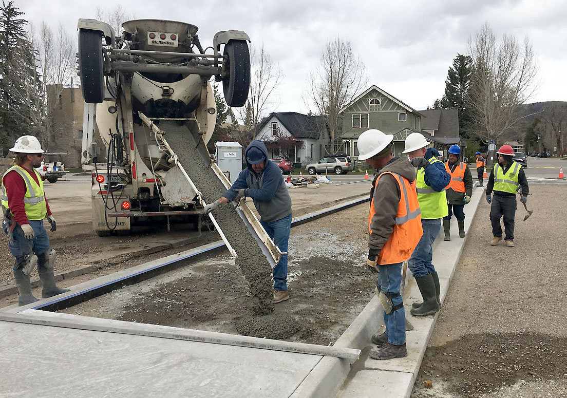 Employees of Native Excavating stand by May 1 to spread concrete for a new sidewalk adjacent to the usually busy Eighth Street parking lot in downtown Steamboat Springs.