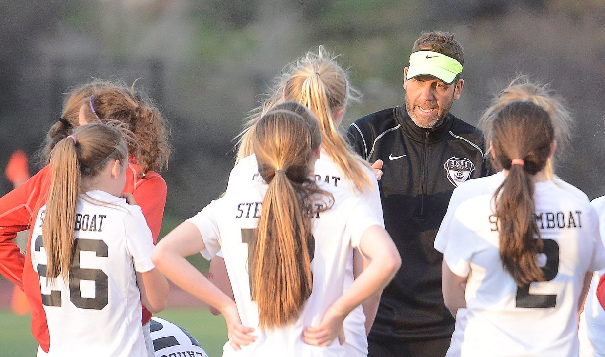 Rob Bohlmann tries to pump up his team Friday before the first overtime period.