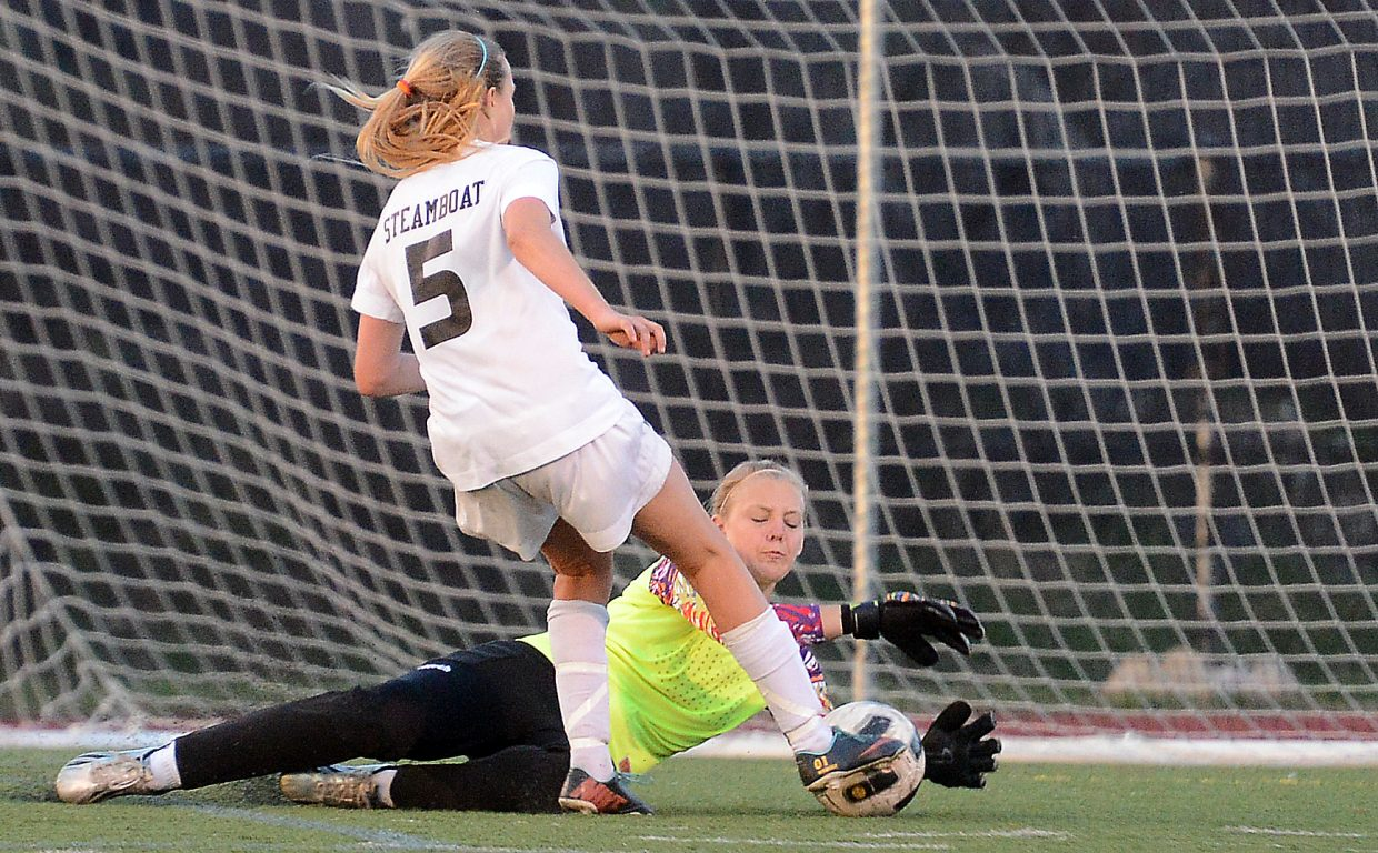 Brooke Buchanan tries to slip the ball by Fruita goalie Elie Bardi. The ball got by, but it didn't roll into the net.
