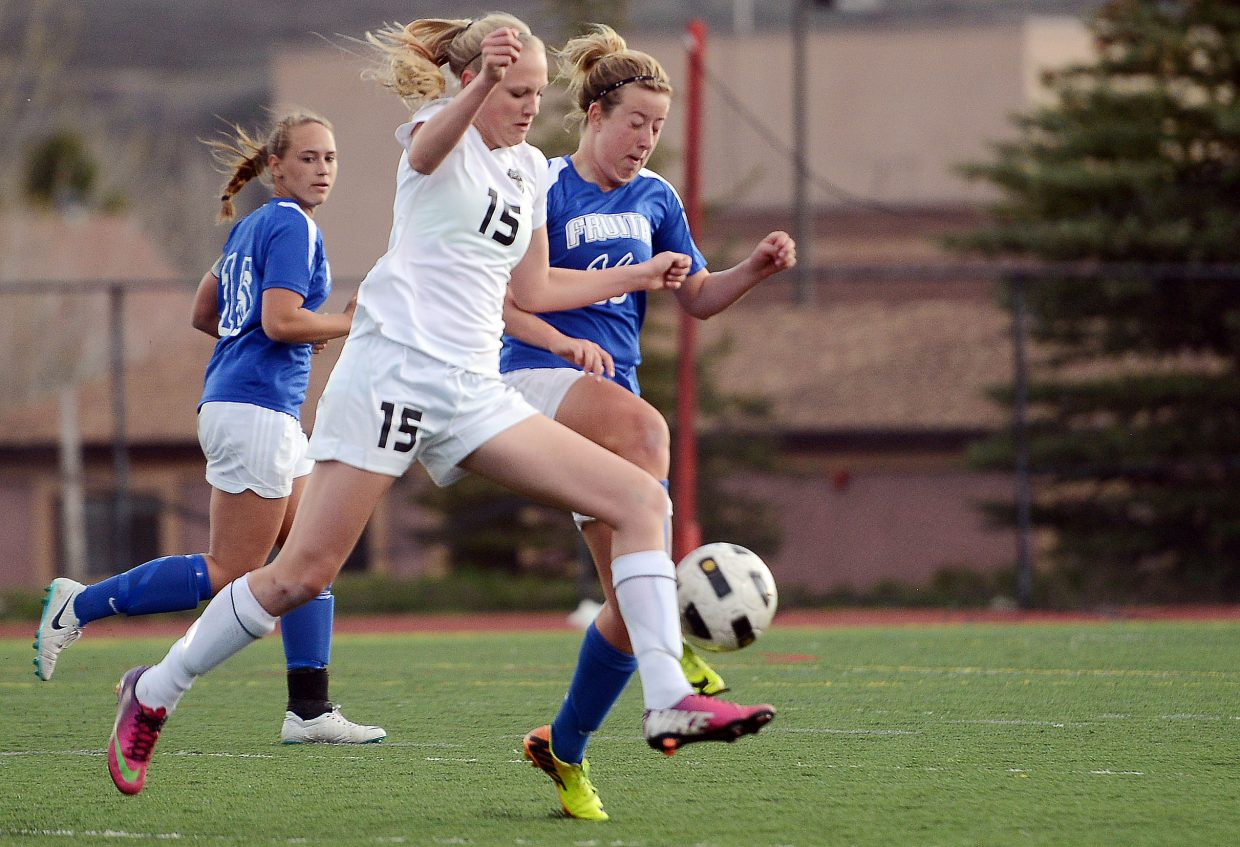 Steamboat's Maggie Henry fights for a ball Friday.