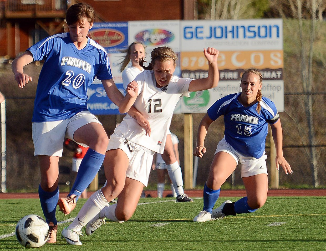 Steamboat's Natalie Bohlmann and Fruita's Elizabeth Downing crash in a race for the ball Friday.