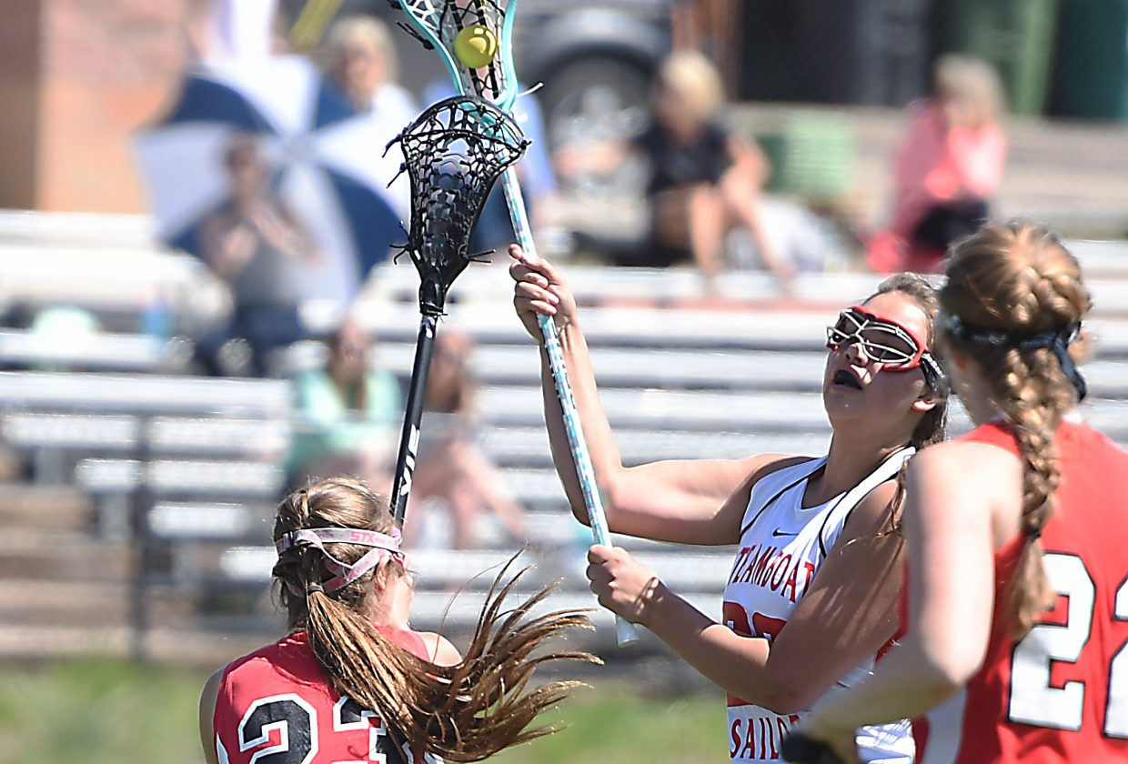 Steamboat Springs senior Kaelyn Kauffmann takes aim for a shot Saturday as the girls lacrosse team played its final game of the season at home against Aspen. The Sailors lost, 24-4.