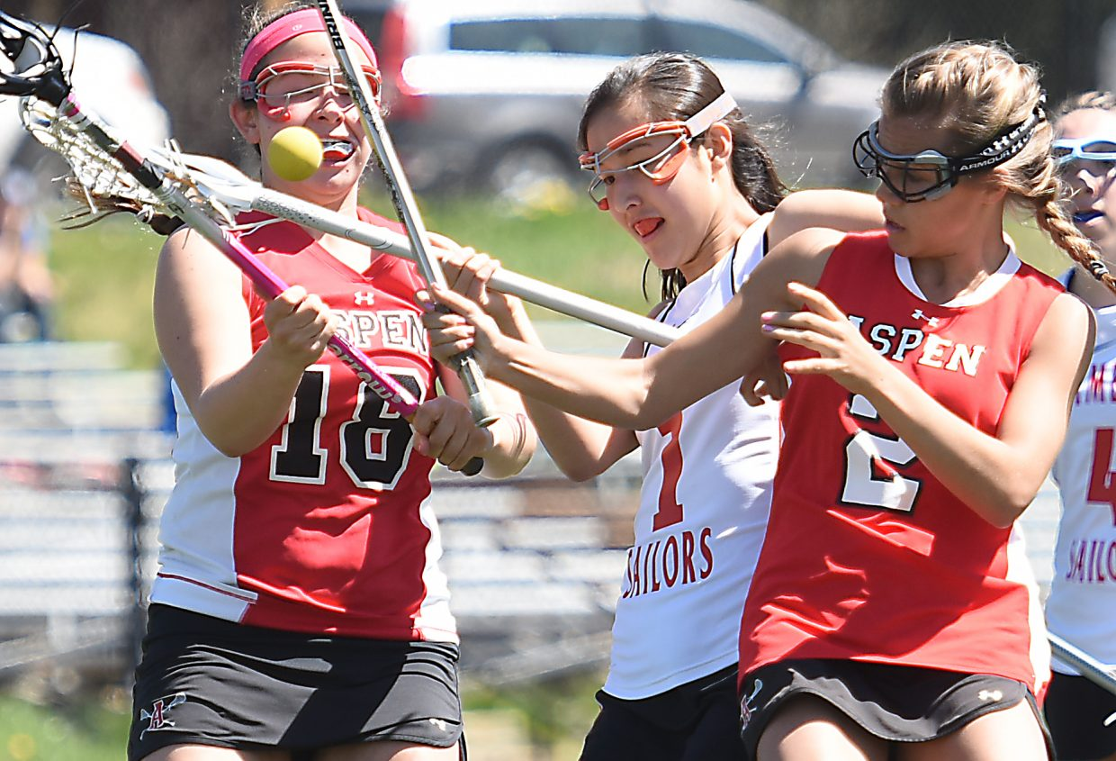 Steamboat's Emi Constantini fights for a ball Saturday against Aspen.