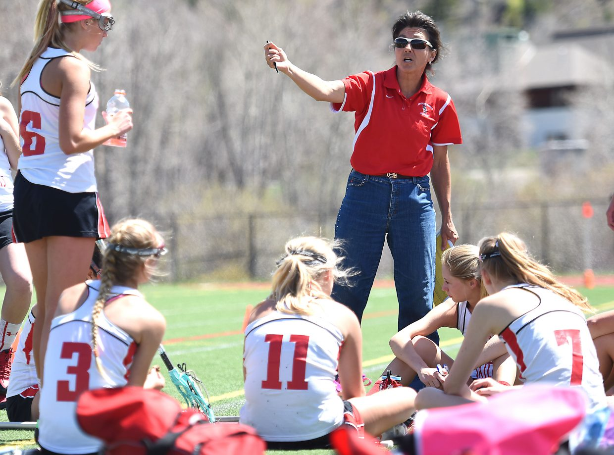 Steamboat girls lacrosse coach Betsy Frick talks to her team during a timeout Saturday as it played Aspen.