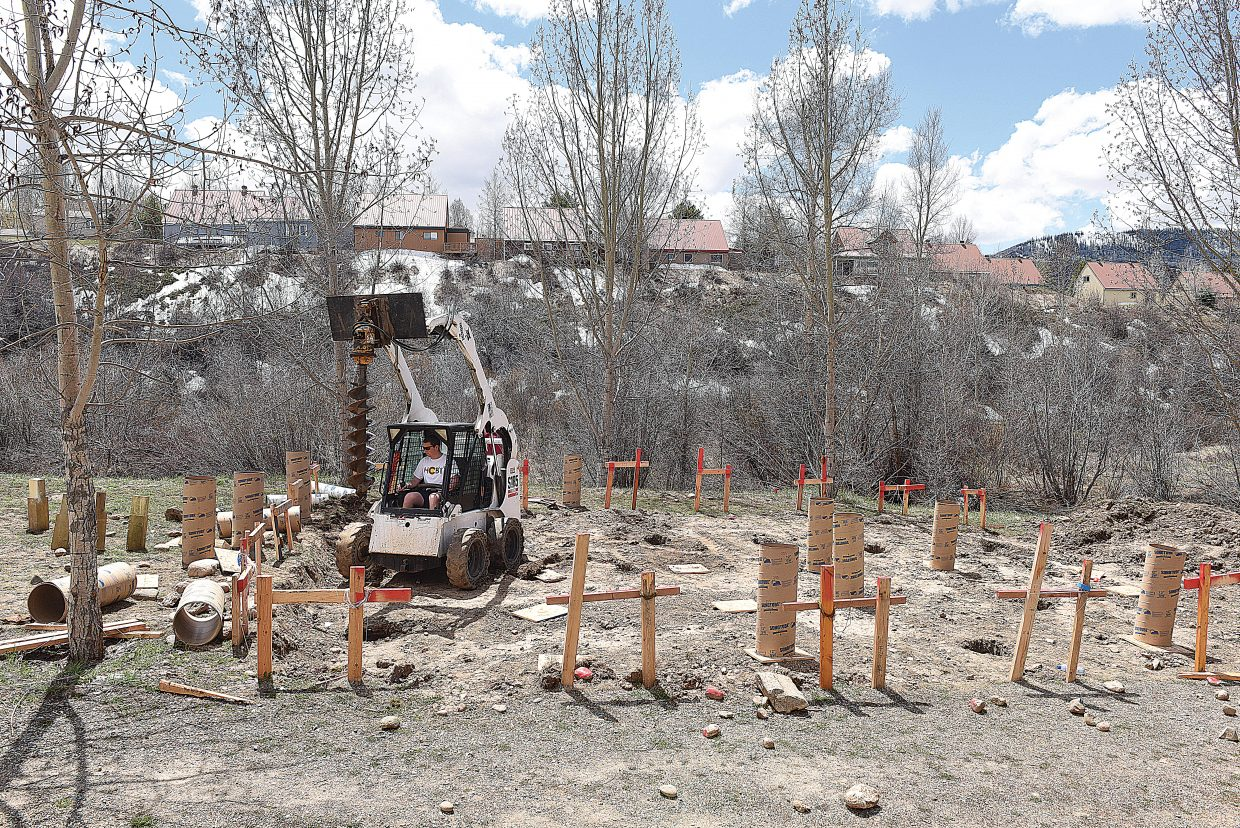 Steamboat Springs High School student Jacob Taulman uses a small tractor while working on a new outdoor stage and learning area behind the Steamboat Springs High School. Students are helping build the new structure, which will replace an older stage that is no longer usable.