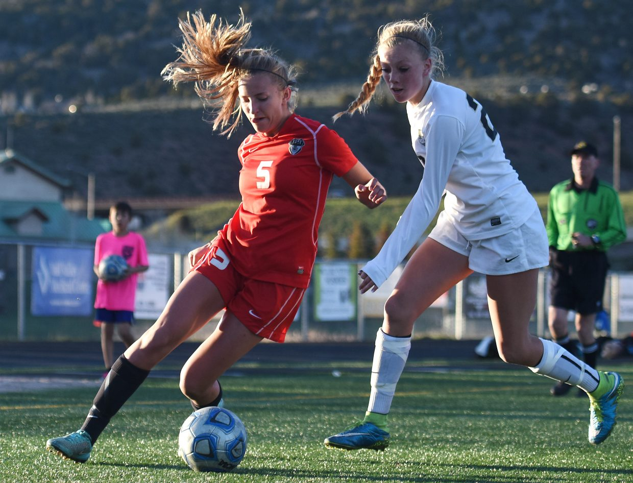 Steamboat junior Brooke Buchanan tries to corral a ball Monday while playing Battle Mountain.