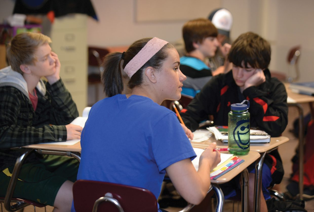 Anna Burkholder listens to her teacher at Steamboat Springs High School last week. Some of those most impacted by Common Core are the teachers who are responsible for implementing new standards and curriculum.