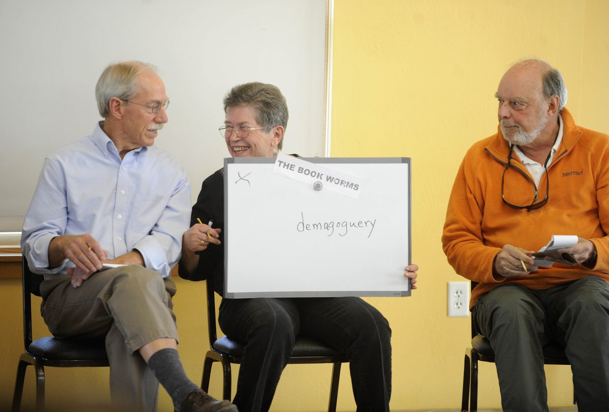 Members of The Book Worms team celebrate after spelling a word correctly during the Community Spelling Bee on Saturday at the Steamboat Springs Community Center. Proceeds from the event went to help fund senior services. The Lift-Up Lexicographers won the competition by spelling the word inveigle.