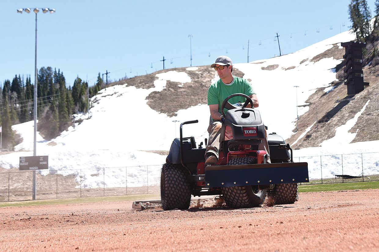 Parks and Community Services employee Nicholas Carelli drags Adams Field in preparation for a youth baseball tryouts. Last week's wet, cold weather seems to have given way to the arrival of spring as local fields have come to life with youth sports practice and people out enjoying the sun.